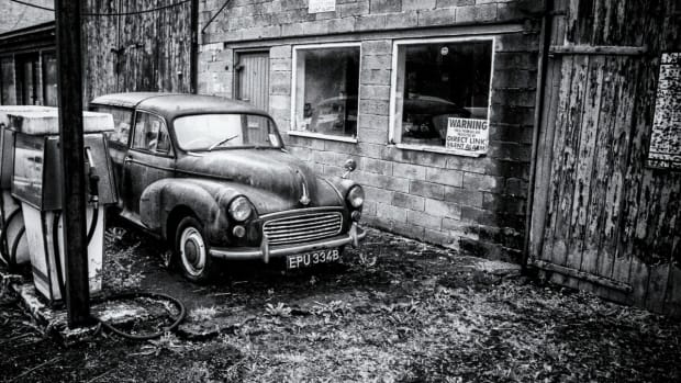 old gas station and car black and white photo by Colin Reynolds