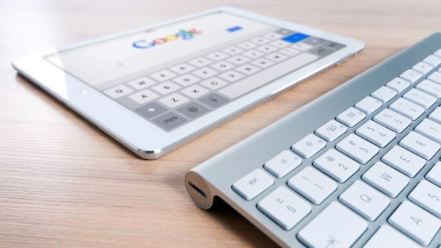 Apple tablet keyboard Google search blurred