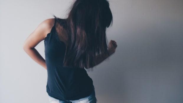 women in a black sleeveless shirt