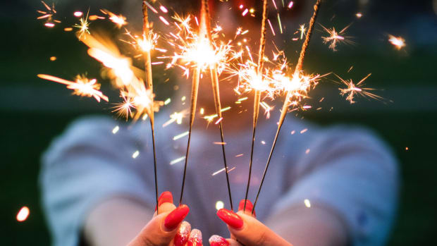 woman holding sparklers celebrate