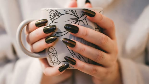 woman-in-black-nail-polish-holding-a-mug