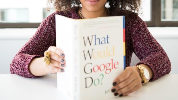 woman holding Google book