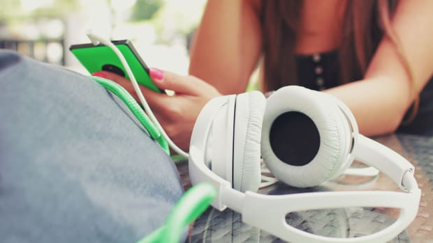 girl listening music headphones
