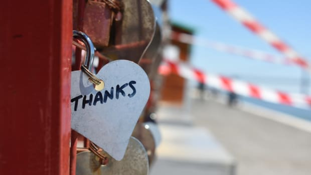 Silver colored heart lock with thank you on bridge