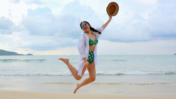 woman beach-bikini-braided-hair-carefree