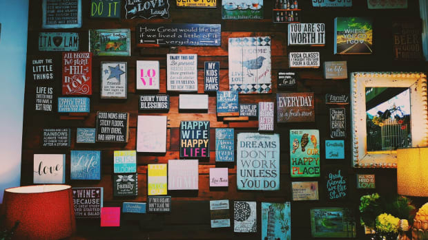 assorted inspiring quote boards on wall
