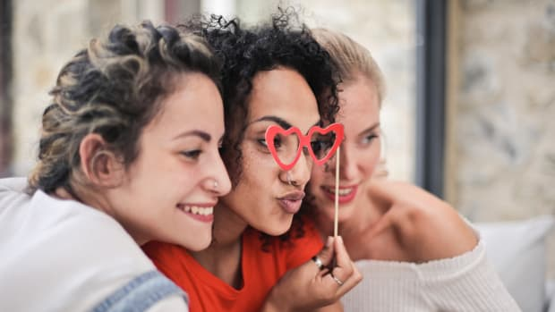 three women posing for photo heart shaped glasses