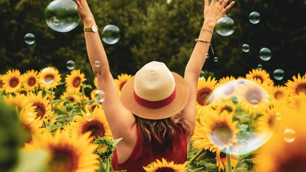 woman surrounded by sunflowers bubbles