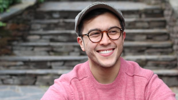 Young man wearing glasses and hat