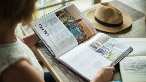 woman reading a travel book on New York