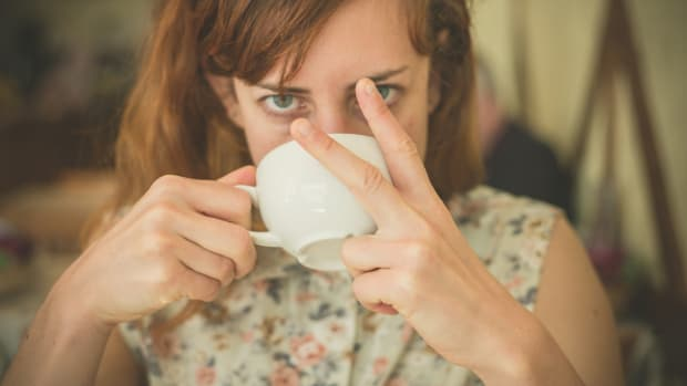 Woman drinking coffee and swearing