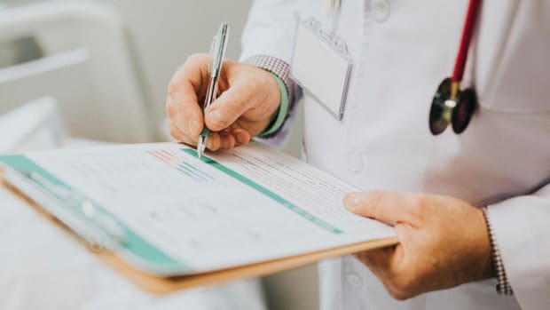 doctor writing medical report