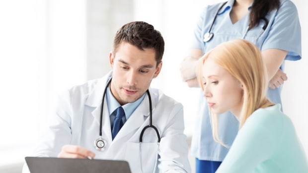 doctor and nurse consulting patient
