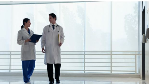 two doctors talking in a hospital