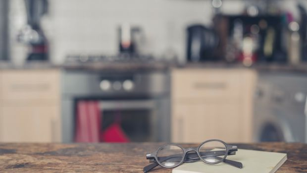 kitchen counter with notepad and glasses