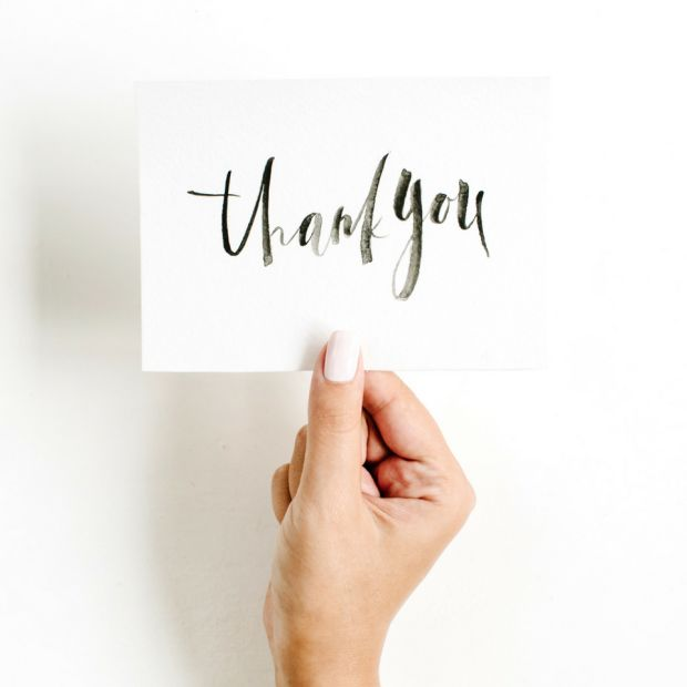 girl holding thank you card