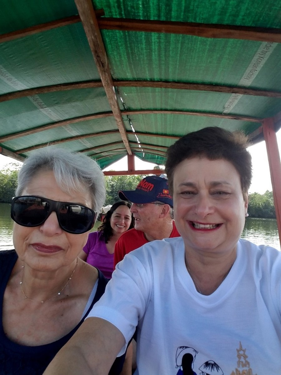 On a river boat ride in Cambodia.