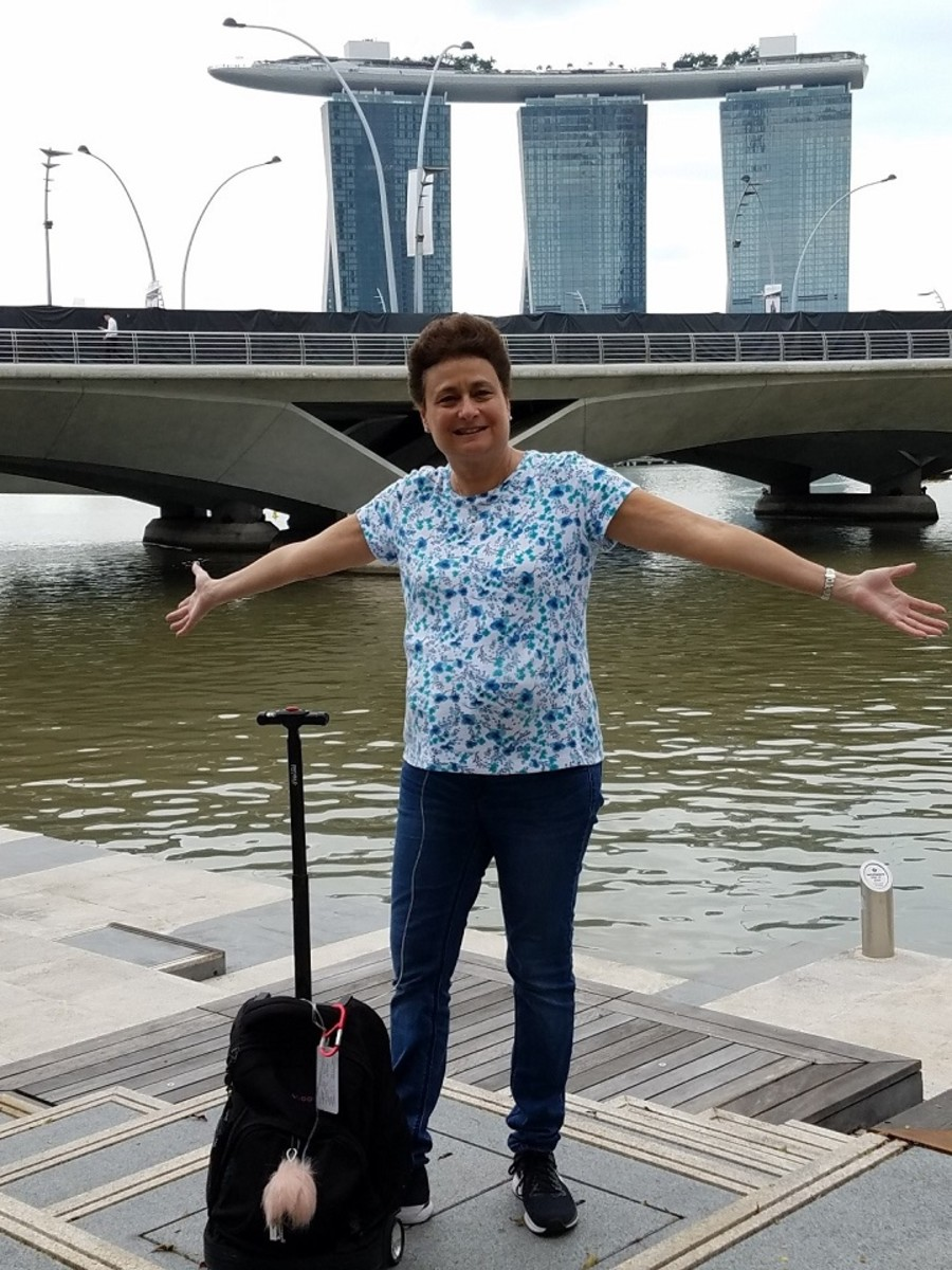 In front of the famous Marina Sands Hotel in Singapore.