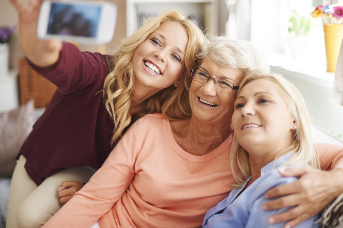women smiling taking selfie