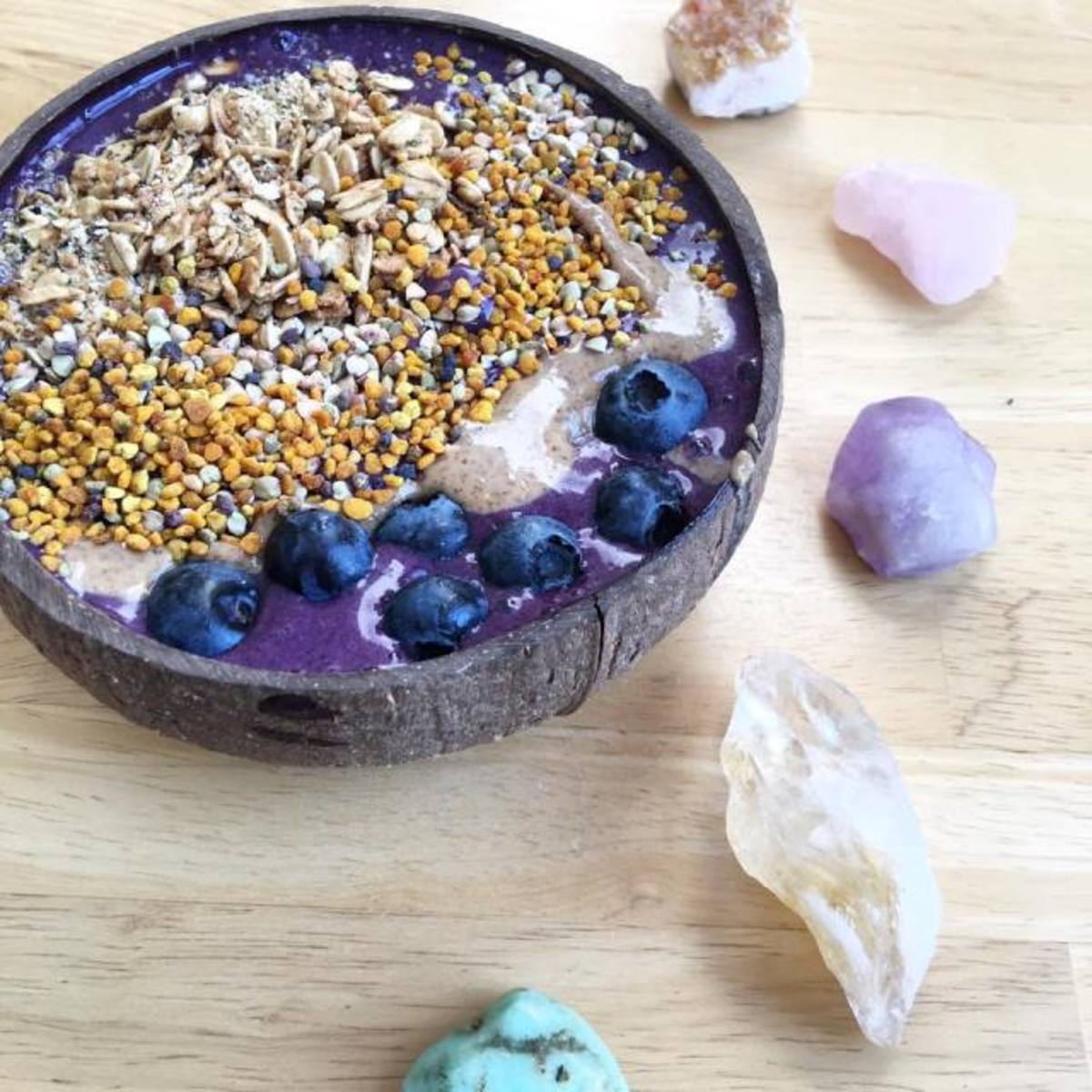 Blended bananas, wild blueberries, vitamin c powder, Sunwarrior Protein, and water. Topped with sprouted granola, wild bee pollen, buckwheat groats, almond butter & blueberries.