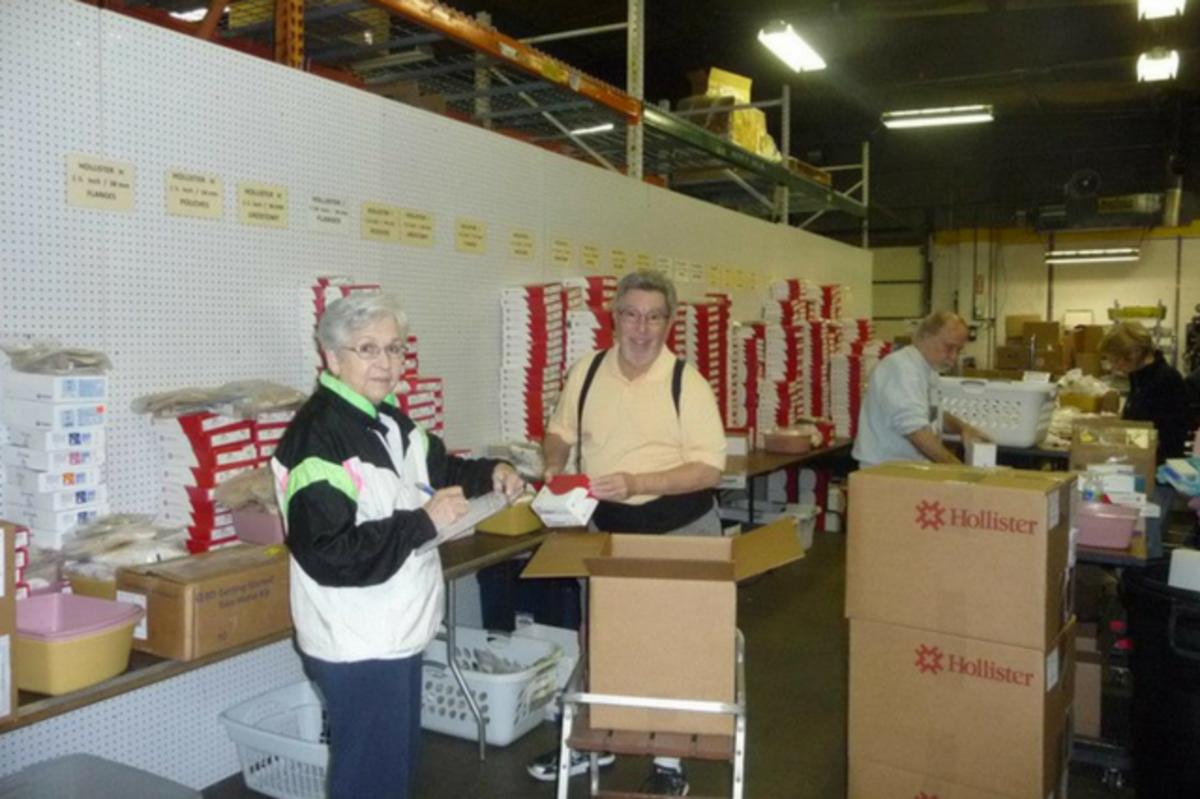 Joy Rhodes and Mickey Heideman in the warehouse