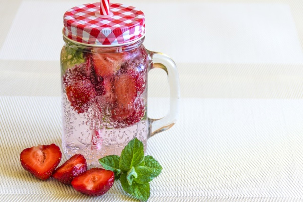 glass of water with strawberries