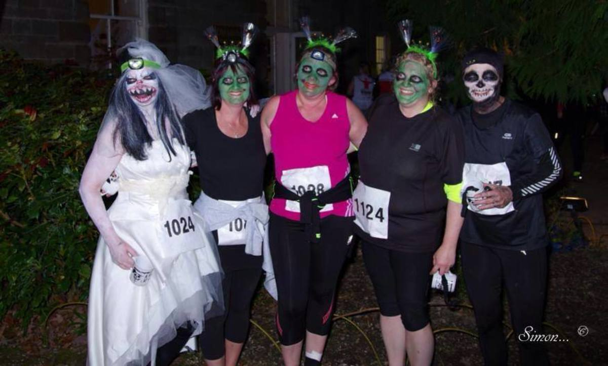 (on left) Just ran 10k through the woods at Arlington in a wedding dress! 10k of Terror was the appropriate name of the event. Loads of screaming!