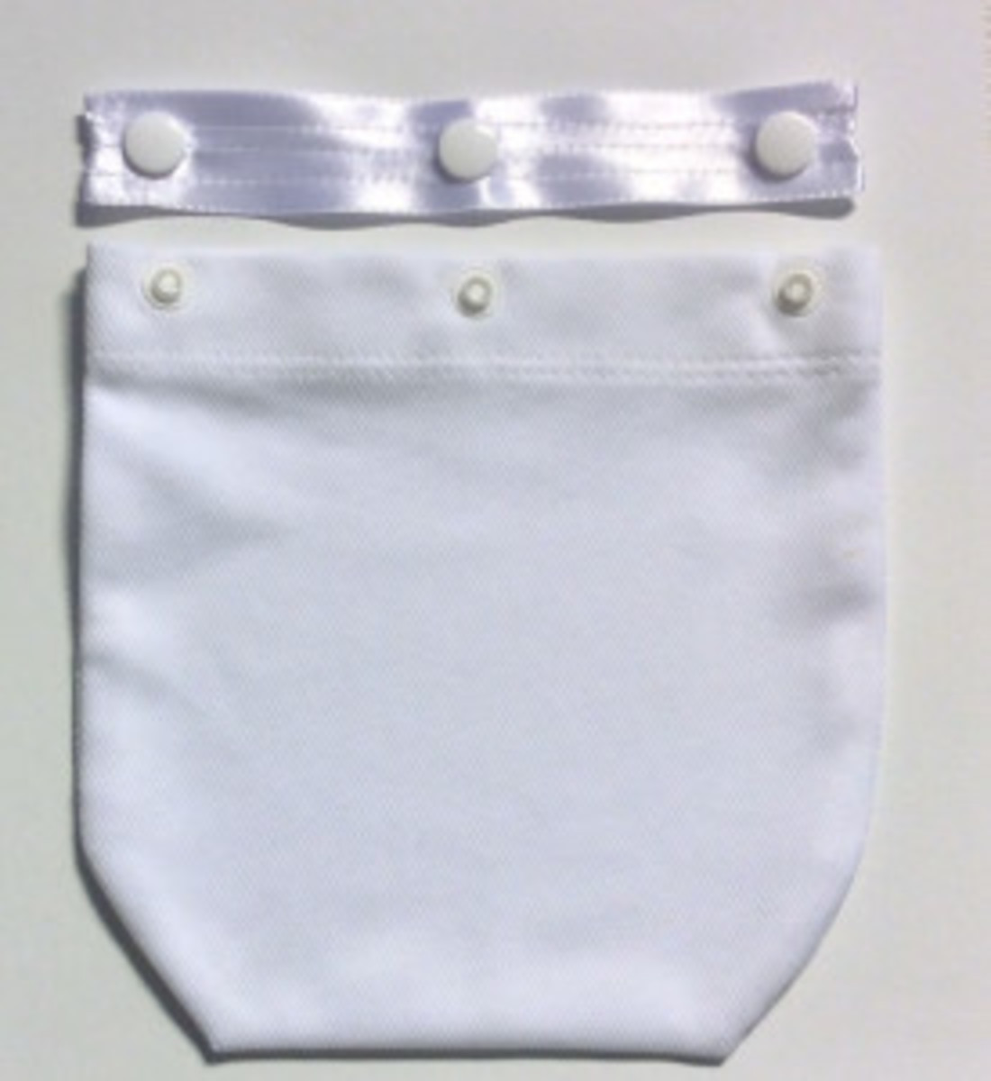 Use the snap strip to secure OstomyPockets to your undergarment. The ostomy pouch can then be inserted into the pocket.