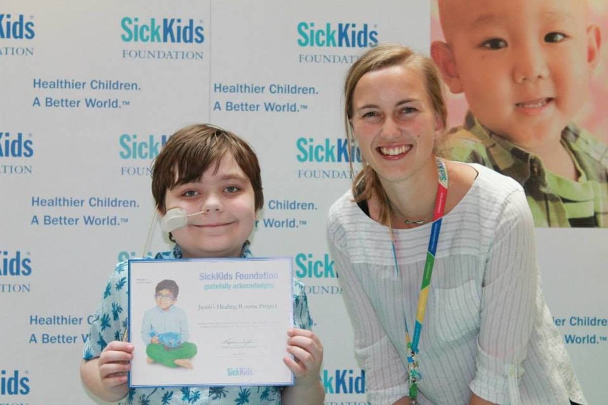 Jacob receiving SickKids Foundation certificate of recognition.