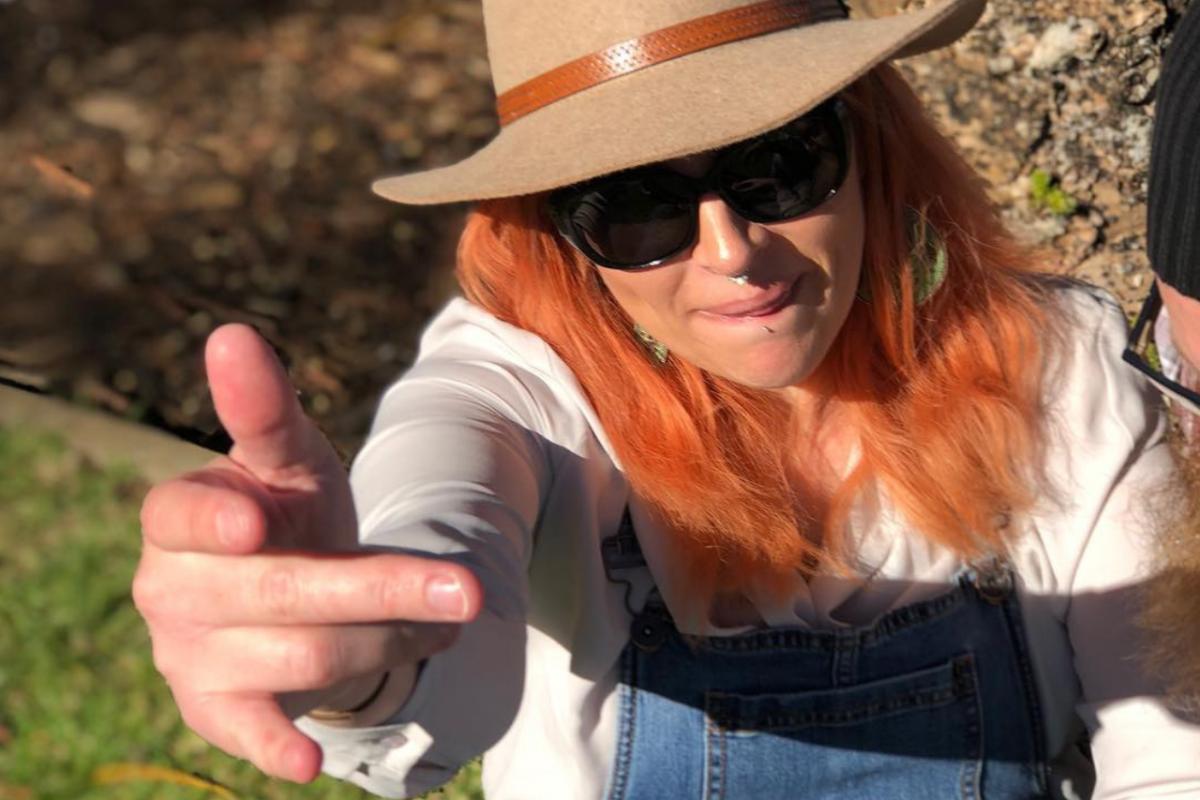 Krystal Miller Bag Lady Mama wearing hat swearing