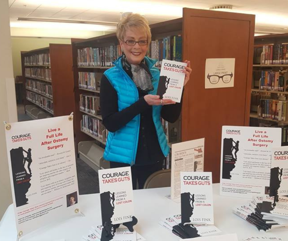 Lois Fink at book signing for Courage Takes Guts